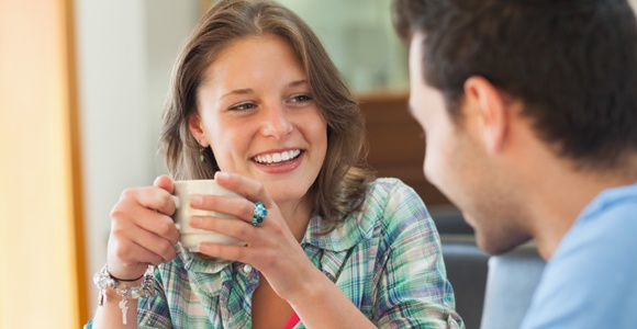 Woman Smiling to a Man