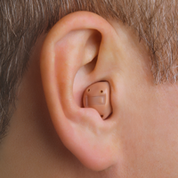 behind-the-ear-hearing-aid-on-ear-BTE.jpg
